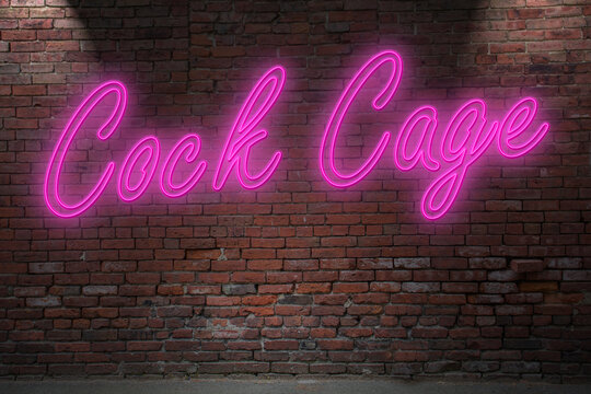 Neon Cock Cage lettering on Brick Wall at night