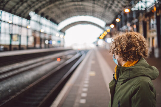 Woman Wearing Mask Standing On Platform