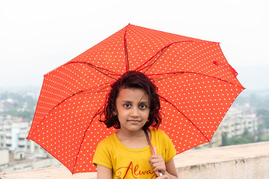 Portrait Of A Girl Standing With Umbrella