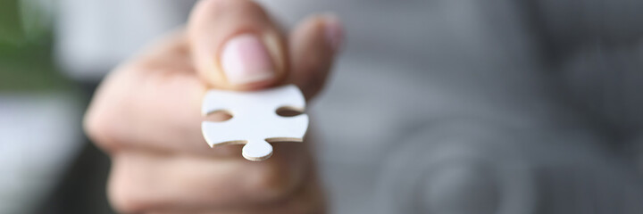 Obraz Male fingers are holding one white puzzle. - fototapety do salonu