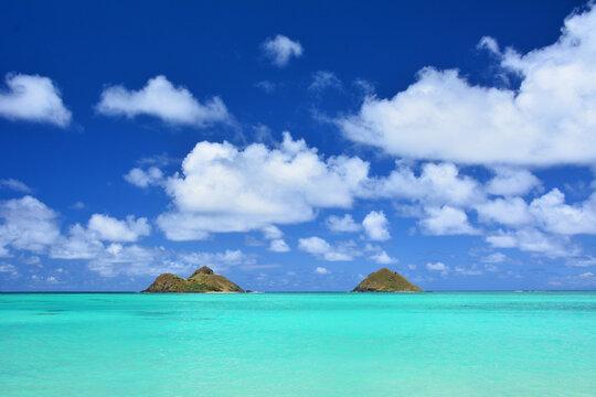Turquoise Waters And Blue Skies At Na Mokulua Aka Mokuluas World Famous Lanikai Beach Oahu, Hawaii.