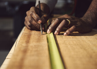 Man Working On Wooden Table