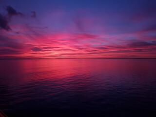 Fototapeta Scenic View Of Sea Against Romantic Sky At Sunset