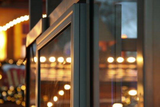Close-up Of Illuminated Lights On Glass Window At Night