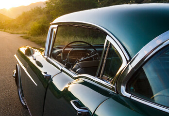Photographs Of A Green Cadillac Standing In The Middle Of A Lonely Road At Sunset