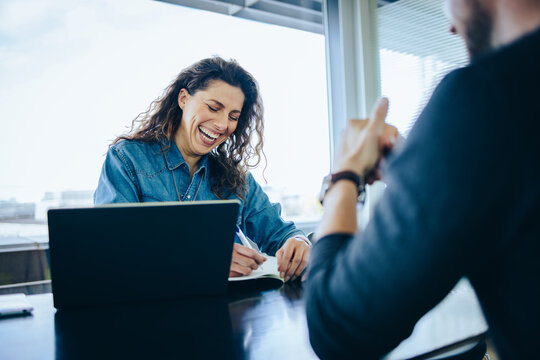 Employer interviewing job applicant and smiling