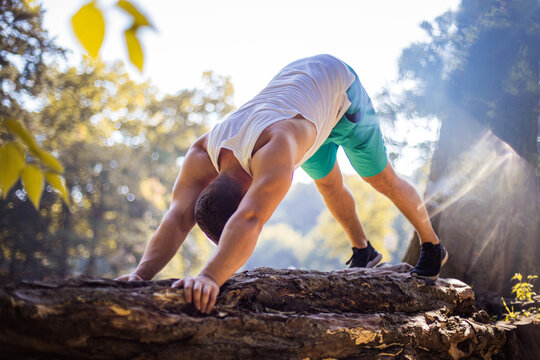 Young man working yoga in the park.