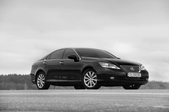 Chernihiv, Ukraine - November 5, 2018: car Lexus ES 350 on the background of the field and sky. Black and white photo