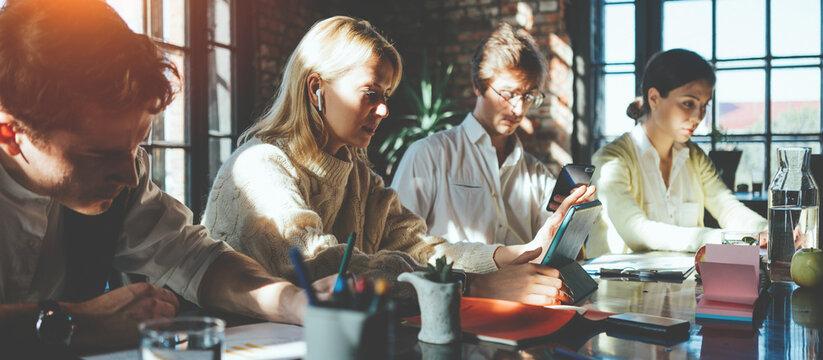 Startup millenials team working together at loft office