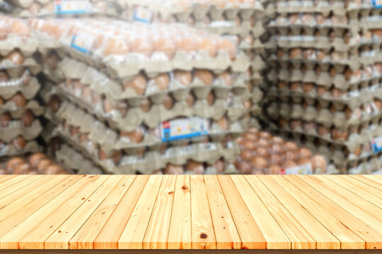 Wooden table background in Chicken egg panel Blur background for placing products.