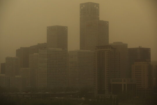 Buildings in the Central Business District are seen shrouded in sand and dust amid a duststorm in Beijing
