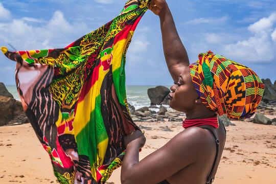 Dancing Ghana Woman On The Beautiful Beach Of Axim, Located In Ghana West Africa.