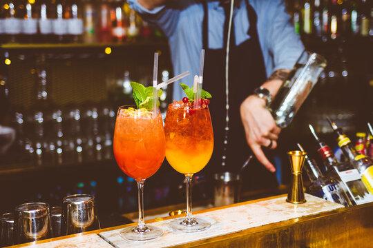 Orange cocktail drinks at a bar
