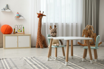 Fototapeta Child's room interior with stylish table, chairs and toys