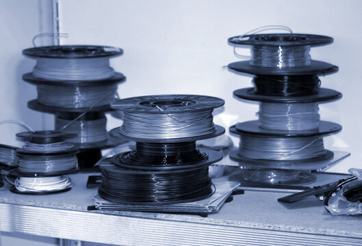 Coils with plastic for 3d printer. Components for modern additive technology