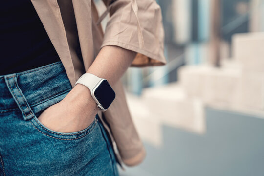 Hands of woman wearing trendy smart watch. Gadget that lets you always stay connected to internet. copy space.