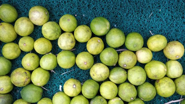 Lot of fresh sweet lemon in a market