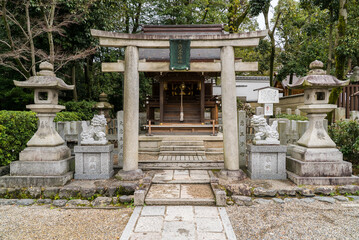 Stone torii gate, Japanese religion Shinto Shrine or Jinja, for prayers and praying.