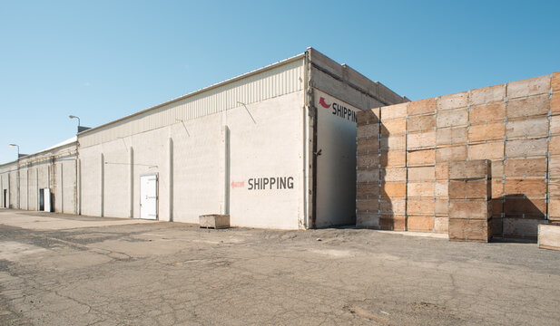 concrete cold room warehouse storage shipping location with red arrow and wood fruit bins yakima washington
