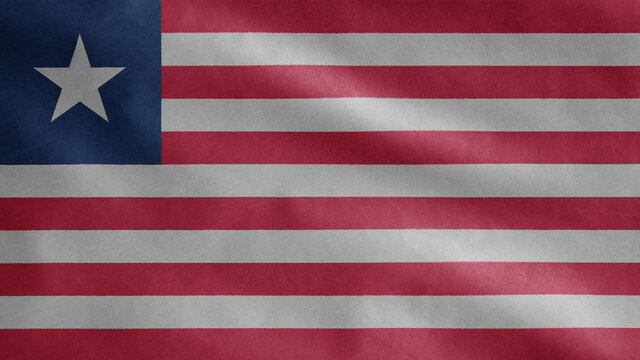 Liberian flag waving in the wind. Liberia banner blowing soft silk.