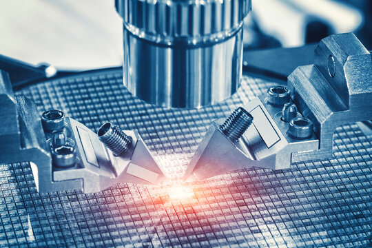 Close up of examining of test sample of microchip transistor under the microscope in laboratory. Equipment for testing microchips. Automation of production. Manufacturing of microchips.