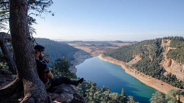 Hiking Man Looking At Aguelmam Azigza