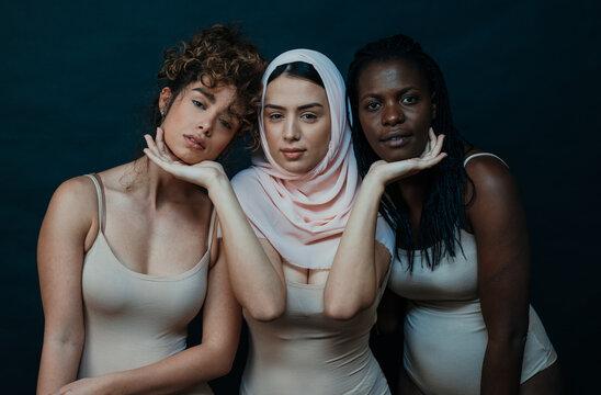 Women Standing Against Black Background