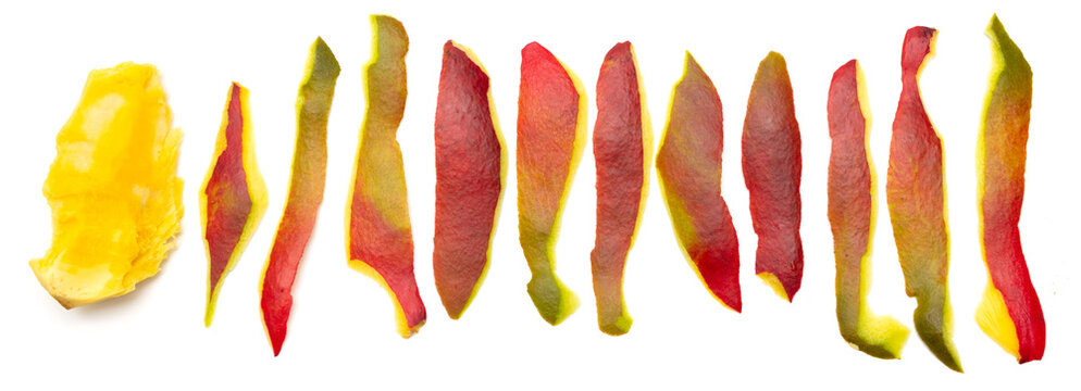 Peeled mango skins on a white background.