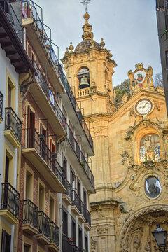 San Sebastian, Spain - Jan 10, 2021: the narrow streets and Basilica Church of Parte Vieja in the early morning