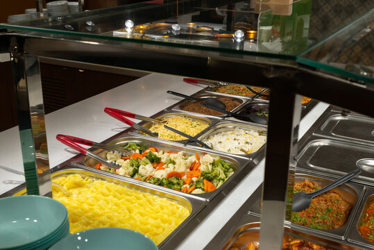 Side dishes on the serving line, self-service restaurant. steamed vegetables, rice, buckwheat, potatoes. Copispace.