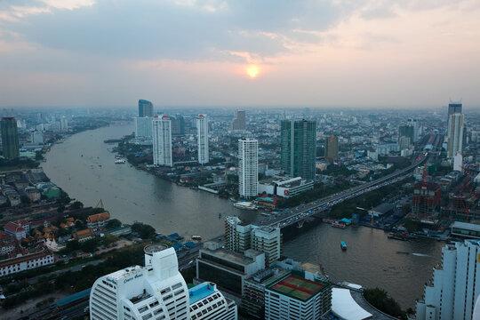 View over Bangkok and the Chao Phraya River, at sunset, Thailand