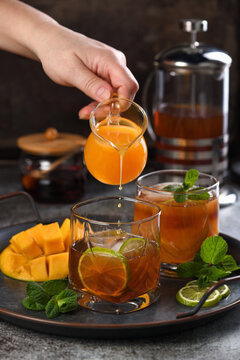 Mango iced tea with lime and mint. Refreshing organic soft drink