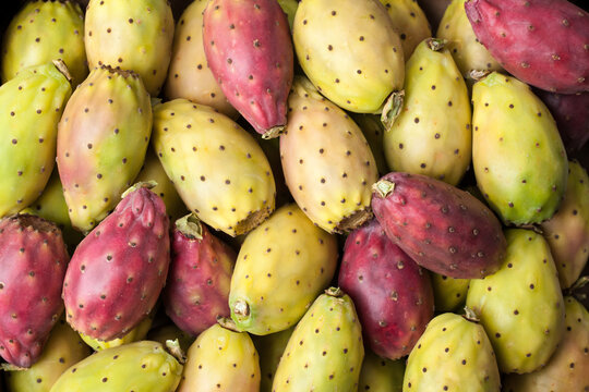 Prickly Pears – Large Group of Raw Sicilian Figs (Opuntia) in Market Box Background, Red and Yellow – Detailed Close-Up Macro, Top View, from Above