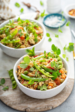 Breakfast fried rice with bacon and peas