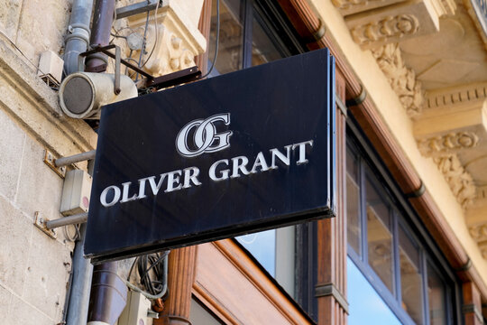 Oliver Grant logo sign and brand text of store luxury shop in street boutique
