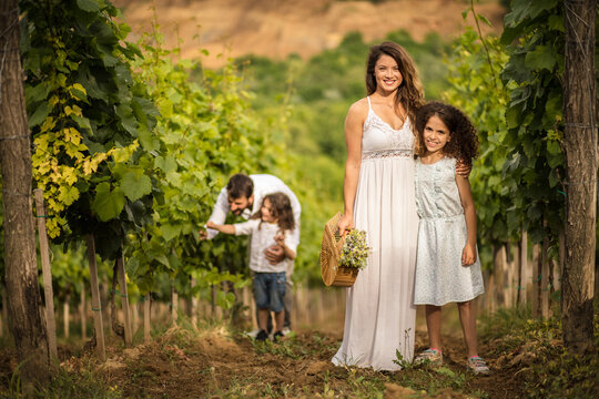 We love nature. Family in the vineyard. Portrait of mother and daughter looking at camera.