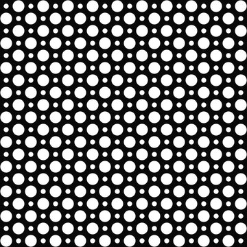 Polka dot pattern of alternating small and large peas. Vector.