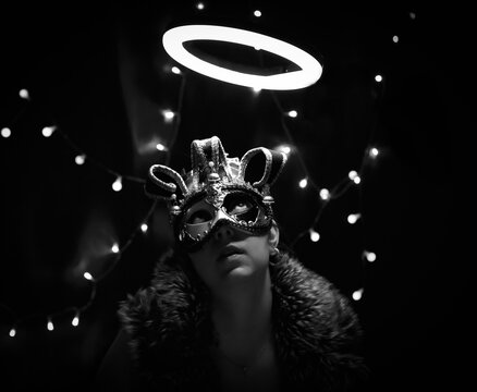 Young woman in a carnival mask.