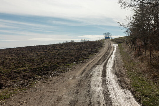 muddy field road in the countryside