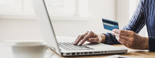Fototapeta Woman using laptop computer with credit card making online order, banner. Business, online shopping, e-commerce, internet banking, spending money, working from home concept obraz