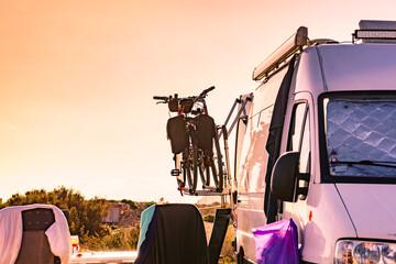 Camper van with bicycles on back rack.