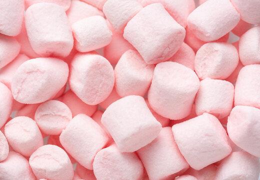 Mini marshmallows of  light pink colors. Selective Focus. Flat lay.