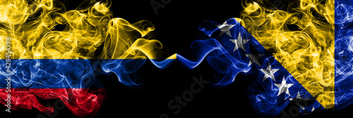 Colombia, Colombian vs Bosnia and Herzegovina, Bosnian, Herzegovinian smoky mystic flags placed side by side. Thick colored silky abstract smokes flags.