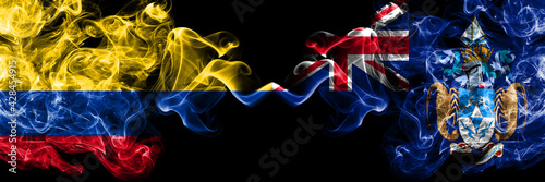 Colombia, Colombian vs British, Britain, Tristan da Cunha smoky mystic flags placed side by side. Thick colored silky abstract smokes flags.