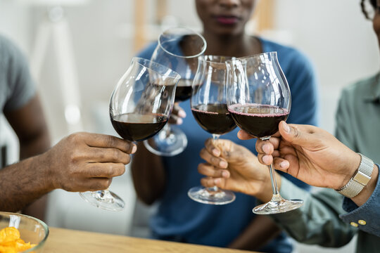 African Friends Red Wine Toast Cheers