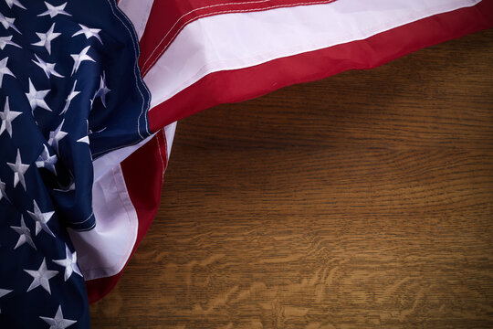 American flag on old wooden board. Celebration frame with free space for text.