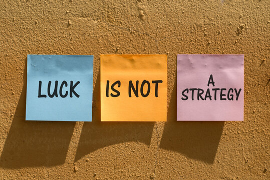 The phrase Luck is not a Strategy on a wall as a reminder that your business or life plans cannot succeed on good fortune alone