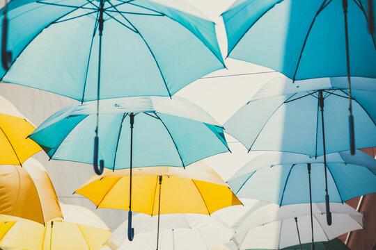 rainy season concept, umbrella use for sunshade public space decoration pattern background