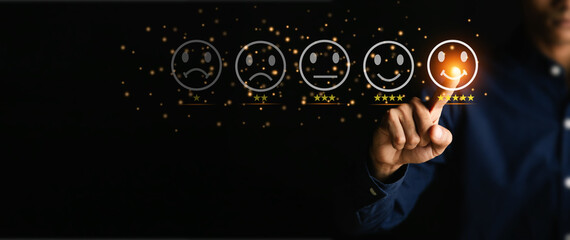 Customer service and Satisfaction concept ,Businessman are touching the virtual screen on the happy Smiley face icon to give satisfaction in service. 5-star rating very impressed.
