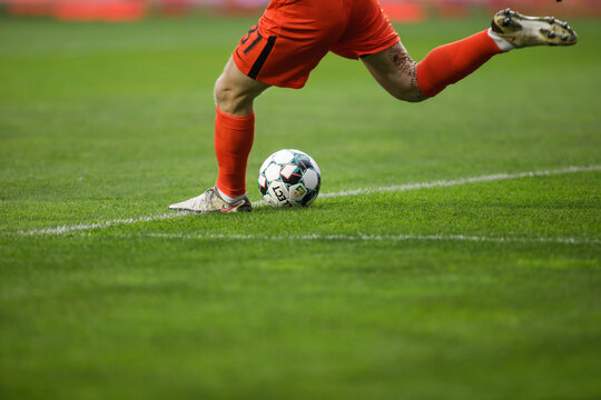 Details with a soccer goalkeeper kicking a ball during a game.